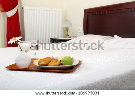 breakfast served on bed - stock photo