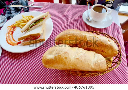 Breakfast set French loaf or baguette and Sandwich with hot coffee - stock photo