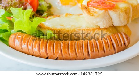 Breakfast set , fried egg , sausage , bread with tomato&cheese - stock photo