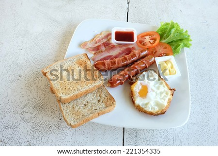 Breakfast set in the white dish - stock photo