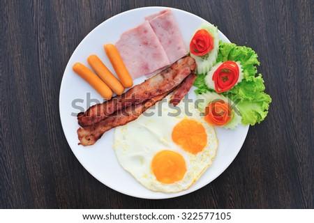 Breakfast set on dish - stock photo