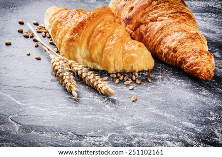 Breakfast setting with fresh croissants  - stock photo