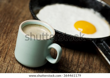 Breakfast setting with fried egg in skillet pan - stock photo