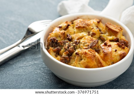 Breakfast strata with cheese and sausage in small baking dish - stock photo
