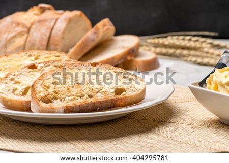 Breakfast table with bread toast with butter and milk with coffee.