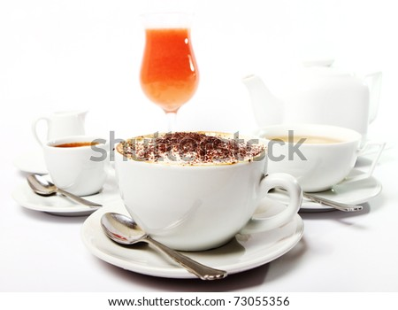 Breakfast table with coffe, tea and juice - stock photo