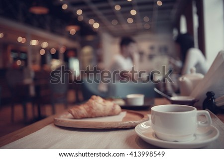 Breakfast tea in a cafe - stock photo