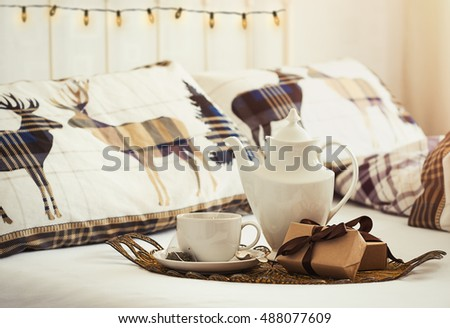 Breakfast tea in bed at Christmas with plenty of copy space for text