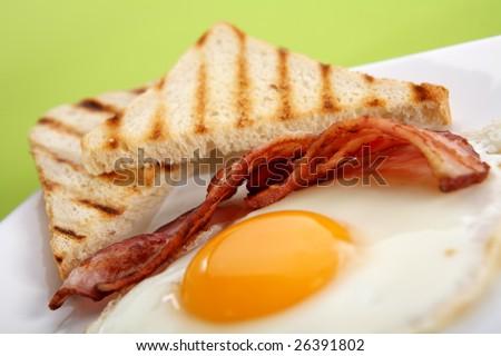 Breakfast - toasts, eggs, bacon - stock photo