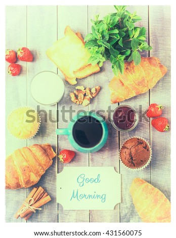 Breakfast Top View. Coffee, Berries and Sweet Cakes on Wooden Background. Rustic Cover Menu. Retro Vintage Toned. - stock photo