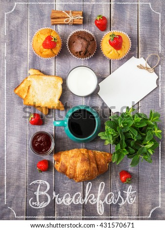 Breakfast Top View. Coffee, Berries, Milk and Sweet Cakes on Wooden Background. Rustic Cover Menu. - stock photo
