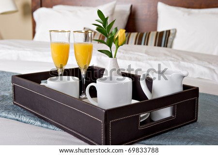 Breakfast tray on a bed - stock photo