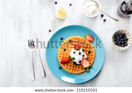 Breakfast waffles with blueberries and strawberries - stock photo