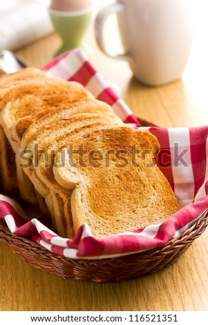 Breakfast. White toasted bread in basket. - stock photo