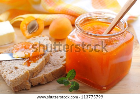 Breakfast with apricot jam and homemade bread - stock photo