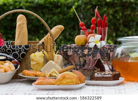 breakfast with bread on fabric in the park  - stock photo
