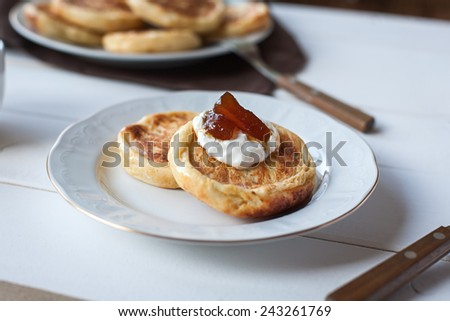 breakfast with cheese pancakes, coffee and jam - stock photo