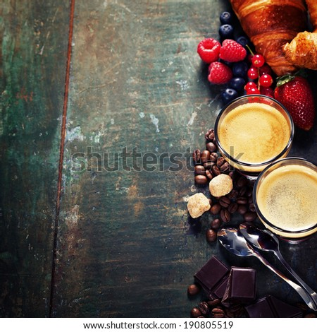 Breakfast with coffee, croissants and berries - stock photo