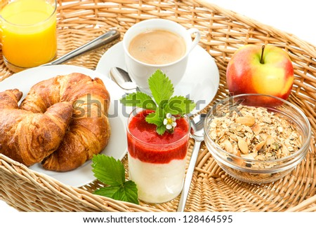 breakfast with coffee, croissants, orange juice and fresh strawberry yogurt - stock photo