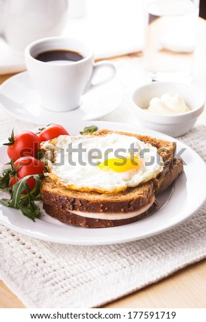 Breakfast with coffee, Croque Madame sandwich - stock photo