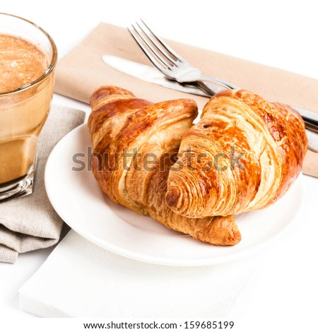 Breakfast with Coffee cup and  Croissants on a plate and linen napkin  isolated on white background, closeup. - stock photo