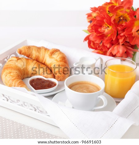 Breakfast with coffee,orange juice and croissant - stock photo