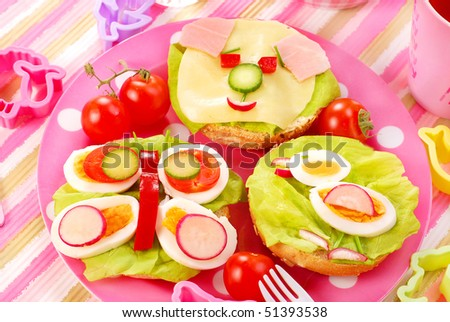 breakfast with cottage cheese for child with butterfly,dog  and chicken  shape sandwich - stock photo