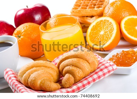 breakfast with croissant, coffee, juice and fruits - stock photo