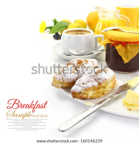 Breakfast with croissants and beverages - stock photo