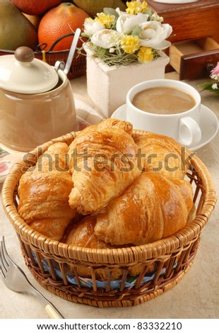 Breakfast with croissants and coffee - stock photo