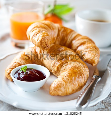 breakfast with croissants,coffee and juice - stock photo