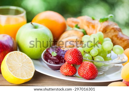 breakfast with croissants,coffee and juice on natural background - stock photo