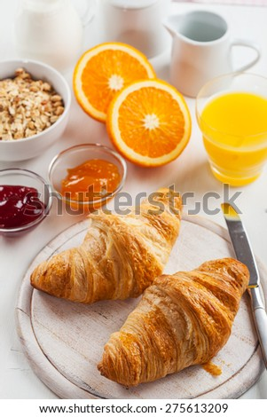 Breakfast with delicious French croissants - stock photo