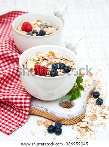 breakfast with fresh berries on a old wooden table