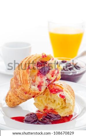 Breakfast with fresh croissant jam coffee and orange juice - stock photo