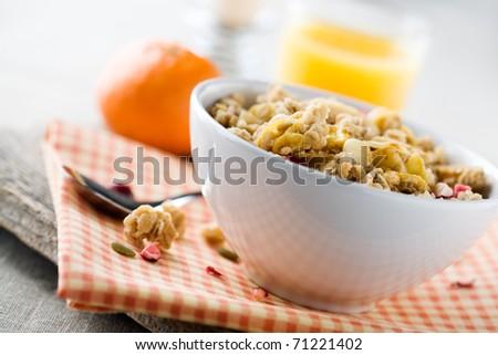 Breakfast with fresh muesli and orange juice - stock photo