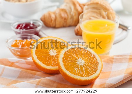Breakfast with fresh orange juice and delicious French croissants - stock photo