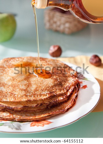 Breakfast with fresh pancakes with syrup and apple - stock photo