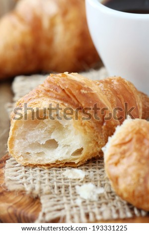 Breakfast with freshly baked croissants and coffee. Shallow DOF