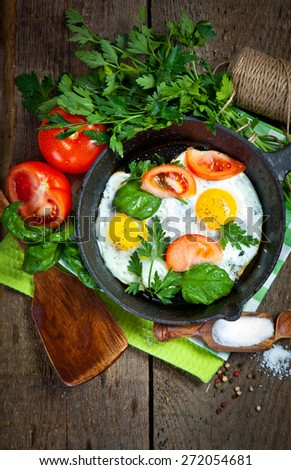 Breakfast with Fried eggs on pan