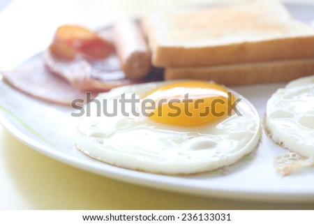 Breakfast with ham , fried egg and bread - stock photo