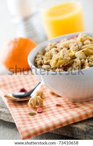 Breakfast with muesli, boiled egg and orange juice - stock photo