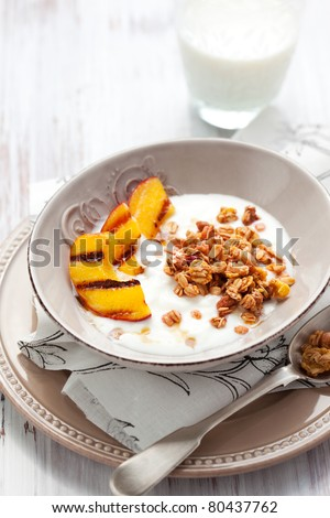 Breakfast with muesli,yogurt and grilled peaches - stock photo