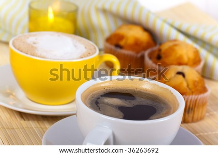 breakfast with muffin,coffee,milk and orange juice