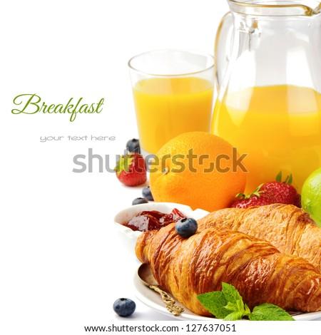 Breakfast with orange juice and fresh croissants - stock photo