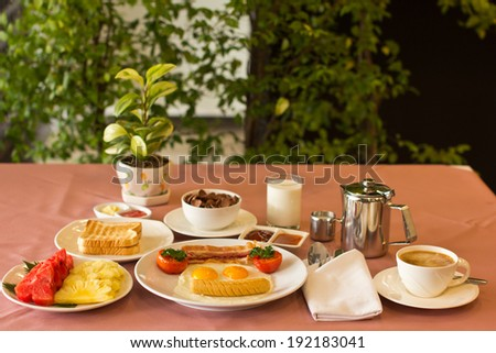 Breakfast with orange juice and fresh fruits on table  - stock photo