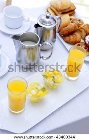 Breakfast with orange juice coffee milk and tea bakery - stock photo