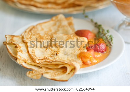 Breakfast with pancakes and apricots jam