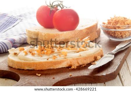 breakfast with pork lard and crispy onion on a slice of bread - stock photo
