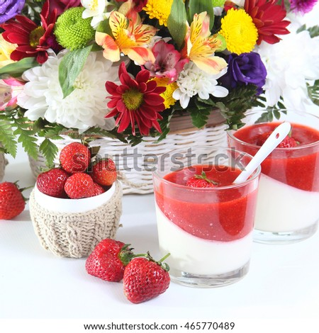 Breakfast with strawberry dessert, fresh berries and flowers